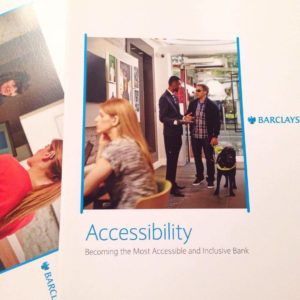 photo of Barclays accessibility pamphlet featuring one person with a guide dog and another wearing a hearing aid.