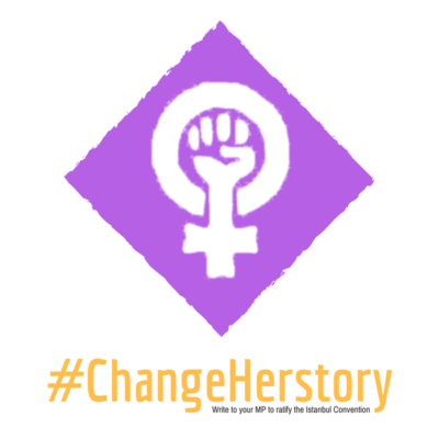 "Purple and white logo. The female gender sign with a clenched fist in the centre. Text says ""#changeherstory write to your MP to ratify the Istanbul Convention"""